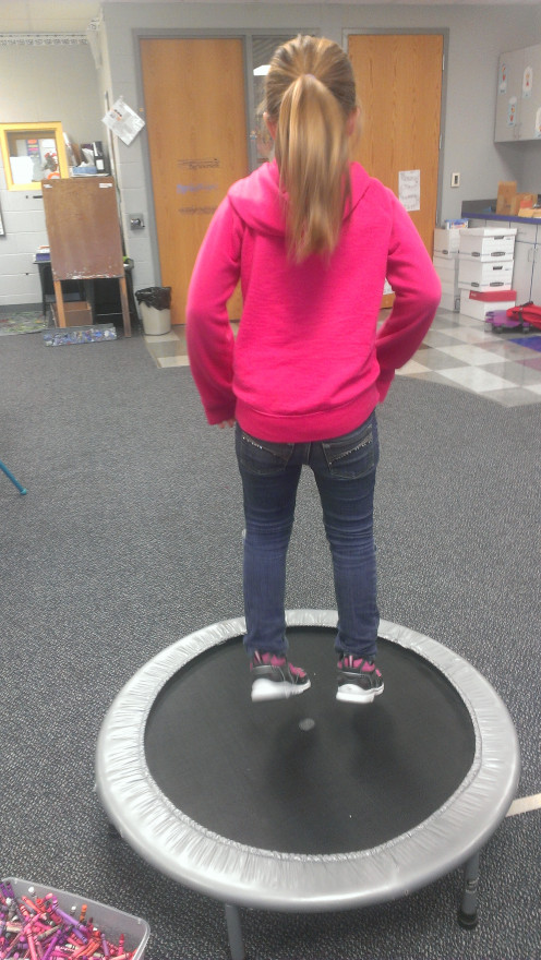 Jumping on a mini-trampoline.