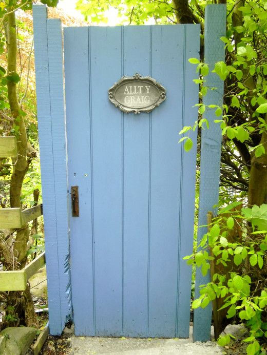 The door which leads to a quaint dwelling from yesteryear.The translaed meand 'The Cliff Faced Forest.'