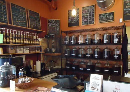 Coffee Shop.  Coffee can be bought in bean form or ready ground.  The coarseness of the grind varies according to type of brewer used.  For instance, a French press requires coarse grinds, whereas an espresso device uses very fine.