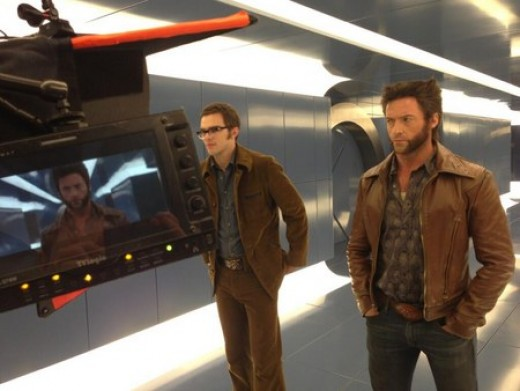 The timelines meet in this set photo of Nicholas Hoult as Beast and Hugh Jackman as Wolverine.