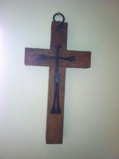 Rough hewed wood with large nails as a Crucifix