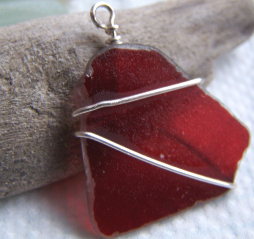 Learninig Wire Work Techniques: A Simple Wire Wrap of Red Sea Glass - one of my first attempts.