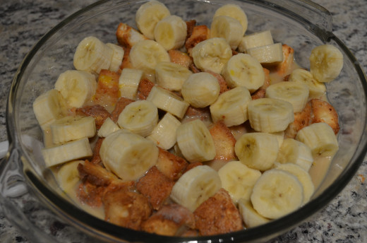Carefully toss bananas, cake, and mixture