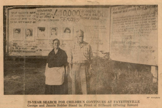 Jennie and George Sodder in an old newspaper article photo standing in front of the billboard they put up in the hope of finding their children.