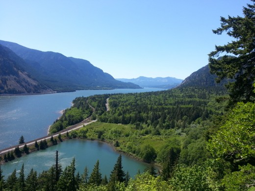 A river, a highway, a cove, and mountains of the Columbia River Gorge.