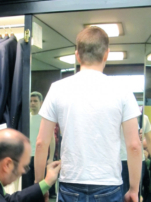 Groom Getting Fitted For Tuxedo