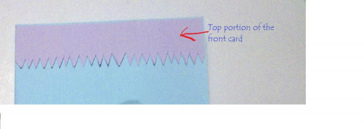 paste the purple jigsaw paper on top the front card