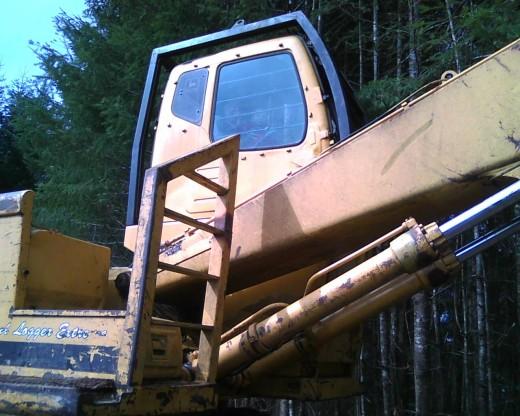 My son inside a log loader.