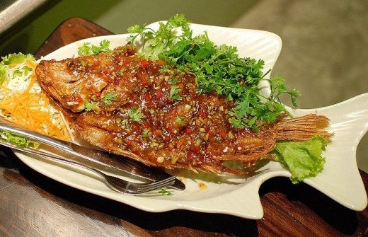 Deep fried Thai fish dish  made with a sweet, spicy, tangy sauce with tamarind, chillies and garlic.
