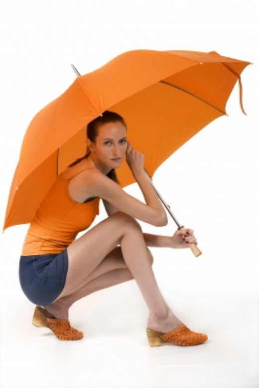Girl Sitting With Umbrella by sattva courtesy of freedigitalphotos