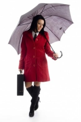 Businesswoman Holding Briefcase and umbrella by imagerymajestic