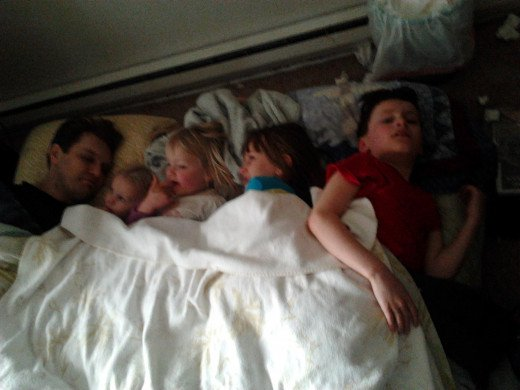 Because somehow, even sick, a mom is bad ass. She took this photo of the brood cuddling.