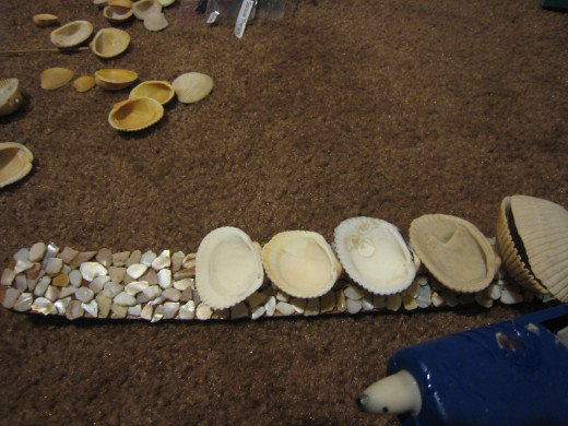 Glue the shells down one by one.