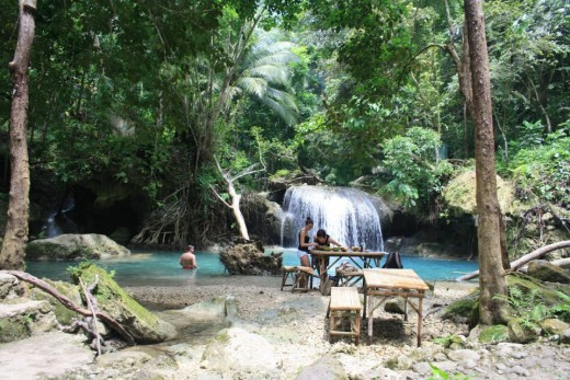 Kawasan Falls, Badian, Cebu, Philippines - swimming in the middle little waterfalls.