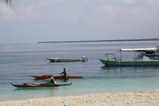White Peeble Sand Beach - Santander, Liloan, Cebu, Philippines - Diving place for most Koreans & Japanese - Fishermen with wooden boats passing by