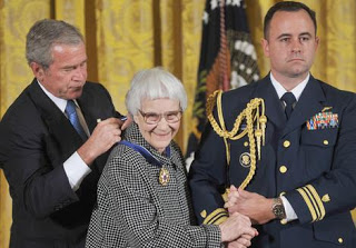 Accepting the Medal of Freedom from then President George W. Bush for her contributions to American literature.