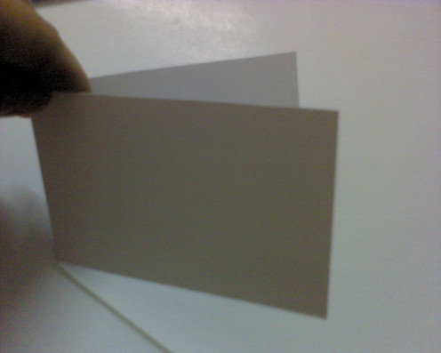 Fold a hard white card into half