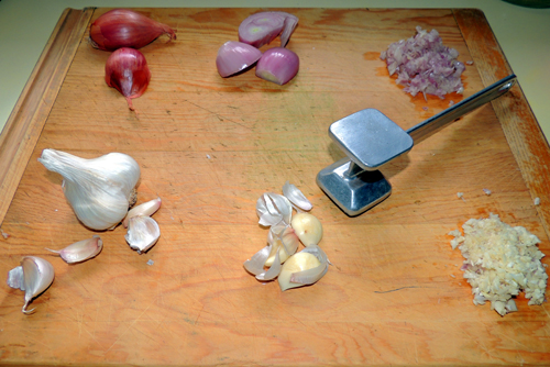 left to right, top to bottom, shallots and garlic prep