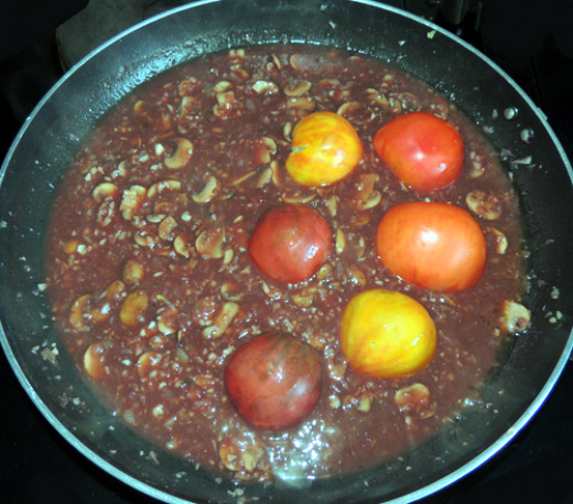 add tomatoes halves, face down