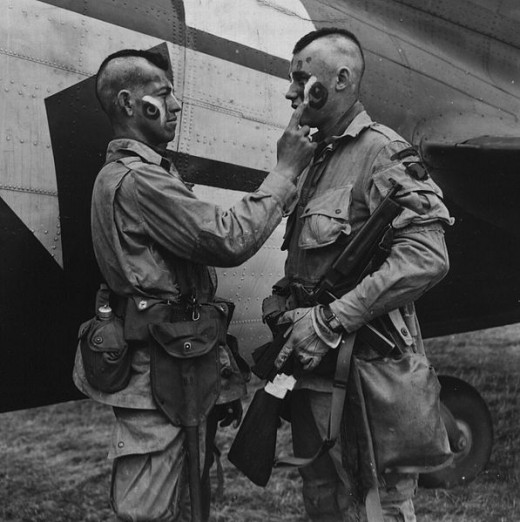 U.S. Paratroopers applying war paint during WWII