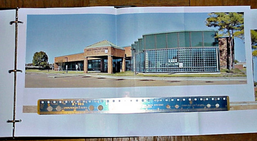 Photo of the 3-panel printout of a panoramic photo of a post office building. The metal ruler shown below the fastened panels is 16 inches long. This poster was printed on a $30 color ink jet printer.