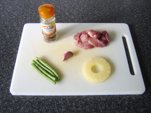 Ingredients for pork, pineapple and green bean spicy stir fry