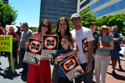 Families protesting together at Pack Square.  Photo by Sophia Phillips Noll