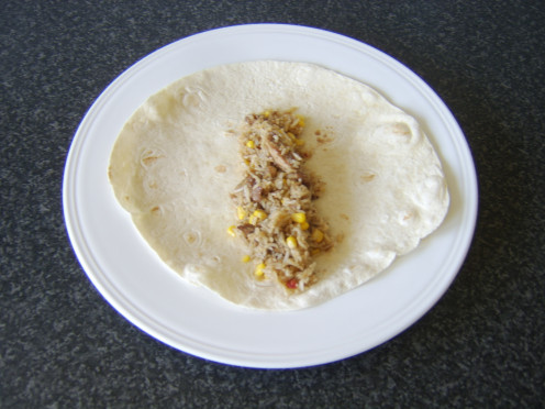 Stir fried leftover roast pork and rice tortilla wrap