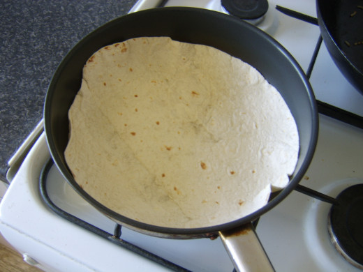 Heating a flour tortilla in a dry frying pan