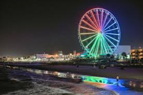 The Ferris Wheel is located beachside and is lit up brightly at night during Spring Break and during the summer months.