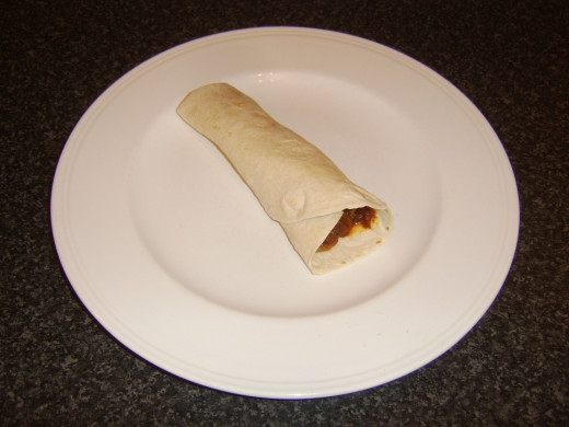 Bhuna spiced pork wrap is served