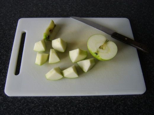Chopping the apple for the shish kebab