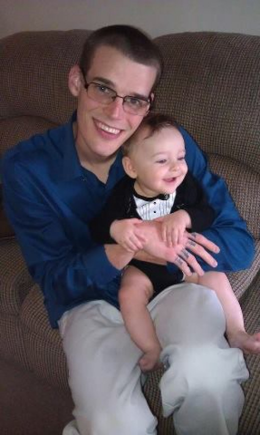 My son with his son, smiling on Easter 2013.  Happy, like father, like son.