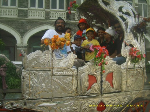 The author with family on a joy ride (Horse cart) before the Taj Hotel building.