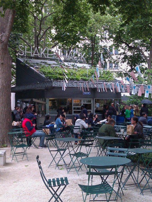 "The Shake Shack blends into the Park's landscape while still boasting a contemporary, hip retro-chic design. The lines get really long, so plan to come early (it opens at 11 a.m.) or simply order a beer or custard from the faster ""B Line."""