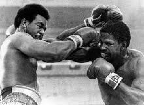 George Foreman and Ron Lyle traded knockdowns before Big George finally prevailed.
