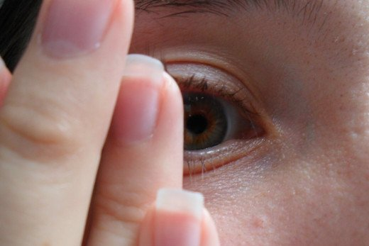 Gently touch your contact with your finger