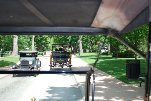 A view from the back seat of a Model T.