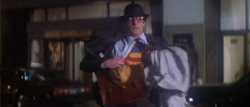Clark Kent strips down and becomes Superman, who is played by Christopher Reeves in the original.