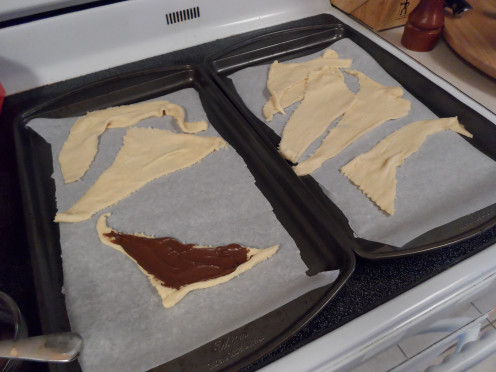 Lay out the crescent rolls and spread the Nutella