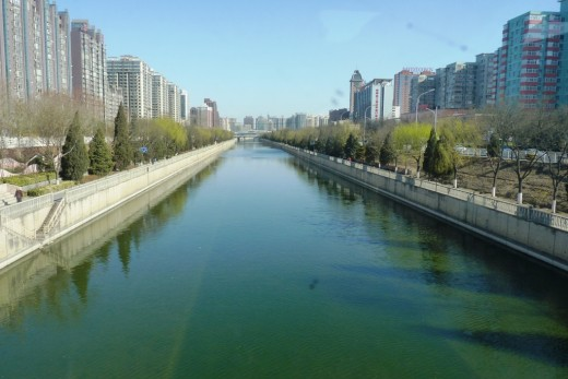 Downtown Beijing showing modern buildings and a canal running through the city