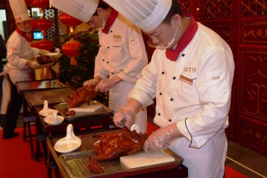 8 b) Chefs carving the Peking Ducks