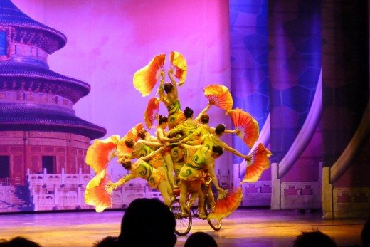 9 b) Nine Chinese ladies on one bicycle at the Chinese Acrobatic show
