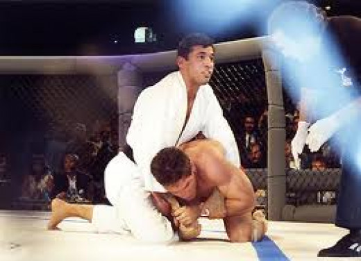 Royce Gracie beat Ken Shamrock in their first Octagon battle in the first ever UFC event. Gracie won by submission in the first round of the match.
