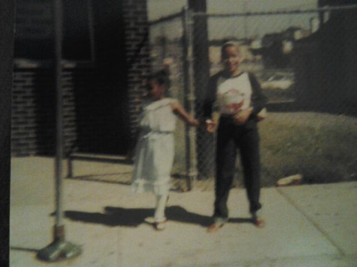 My little sister Keshia and I waiting of the CTA, bus, on 103rd street in Chgo.  I was 20, Keshia 9