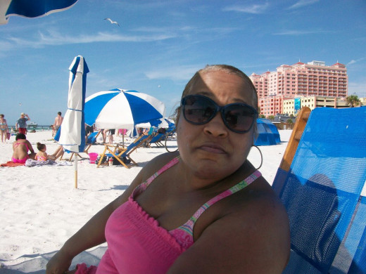 I relaxing under a beach umbrella with a family friend at Clearwater Beach, Fl  May 2013