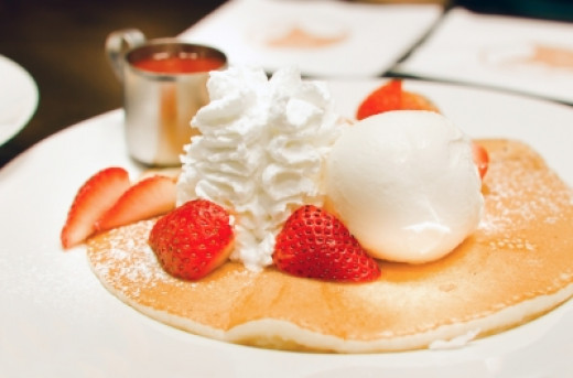 Pancakes with delicious strawberries, ice cream & whipping cream