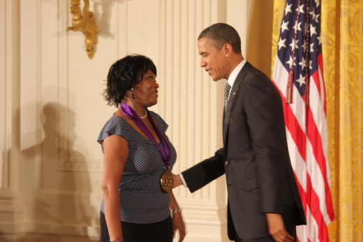 Rita Dove receiving the National Medal of Arts from President Obama in 2011.