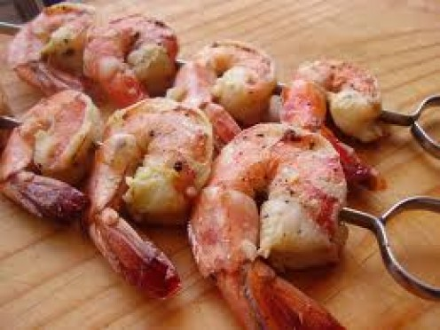 Butter and garlic go together to help make shrimp a delicious food. Cook the shrimp on low and in the butter and they will be good and buttery and very tender.