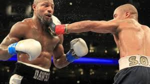 Andre Ward lands a left on Bad Chad Dawson en route to a knockout victory. Ward was the super middleweight champion entering the bout.